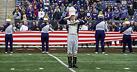 Drum major Denali Cornwell stands at attention during the playing of the national anthem.