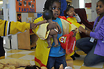 Damarion Jaelks, 2, Angel Dickerson, 3, and teacher Vermail Price, 26, play in Room 129 at the Educare Early Childhood Center in Chicago on November 21, 2008.  The pre-K daycare center is a model for head start, funded privately by the Gates and other foundations, that cares for and educates infants, toddlers, and 3- and 4-year old pre-school children.
