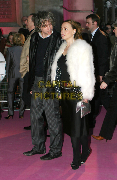 BOB GELDOF & JEANNE MARINE.Private view to open the V&A's major Westwood exhibition.30 March 2004.full length, full-length, white fur coat, silver handbag.www.capitalpictures.com.sales@capitalpictures.com.© Capital Pictures.