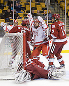 Chris Connolly (BU - 12) - The Boston University Terriers defeated the Harvard University Crimson 3-1 in the opening round of the 2012 Beanpot on Monday, February 6, 2012, at TD Garden in Boston, Massachusetts.