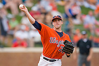 Robert Morey #22 of the Virginia Cavaliers makes a pick-off throw to first base against the St. John's Red Storm at the Charlottesville Regional of the 2010 College World Series at Davenport Field on June 6, 2010, in Charlottesville, Virginia.  The Red Storm defeated the Cavaliers 6-5.   Photo by Brian Westerholt / Four Seam Images