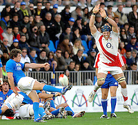 Photo: Omega/Richard Lane Photography. Italy v England. RBBS Six Nations. 10/02/2008. Italy's Pietro Travagli kicks as England's James Haskell charges down.
