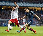 Andrew Robertson cuts inside the box with defender Ucha Lobzhanidze