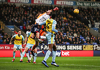 Bolton Wanderers' Christian Doidge competing with Rotherham United's goalkeeper Marek Rodak<br /> <br /> Photographer Andrew Kearns/CameraSport<br /> <br /> The EFL Sky Bet Championship - Bolton Wanderers v Rotherham United - Wednesday 26th December 2018 - University of Bolton Stadium - Bolton<br /> <br /> World Copyright &copy; 2018 CameraSport. All rights reserved. 43 Linden Ave. Countesthorpe. Leicester. England. LE8 5PG - Tel: +44 (0) 116 277 4147 - admin@camerasport.com - www.camerasport.com