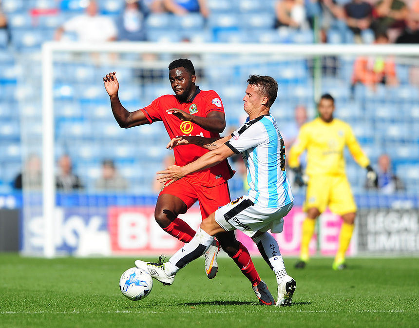 Blackburn Rovers' Hope Akpan vies for possession with Huddersfield Town's Jonathan Hogg<br /> <br /> Photographer Chris Vaughan/CameraSport<br /> <br /> Football - The Football League Sky Bet Championship - Huddersfield Town v Blackburn Rovers - Saturday 15th August 2015 - The John Smith's Stadium - Huddersfield<br /> <br /> &copy; CameraSport - 43 Linden Ave. Countesthorpe. Leicester. England. LE8 5PG - Tel: +44 (0) 116 277 4147 - admin@camerasport.com - www.camerasport.com