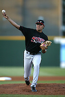 Javier Martinez of the Lake Elsinore Storm pitches during a game against the Rancho Cucamonga Quakes at The Epicenter on July 3, 2003 in Rancho Cucamonga, California. (Larry Goren/Four Seam Images)