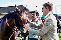 Winning Trainer Richard Hughes greets Beepeecee in the winners enclosure  during Afternoon Racing at Salisbury Racecourse on 13th June 2017