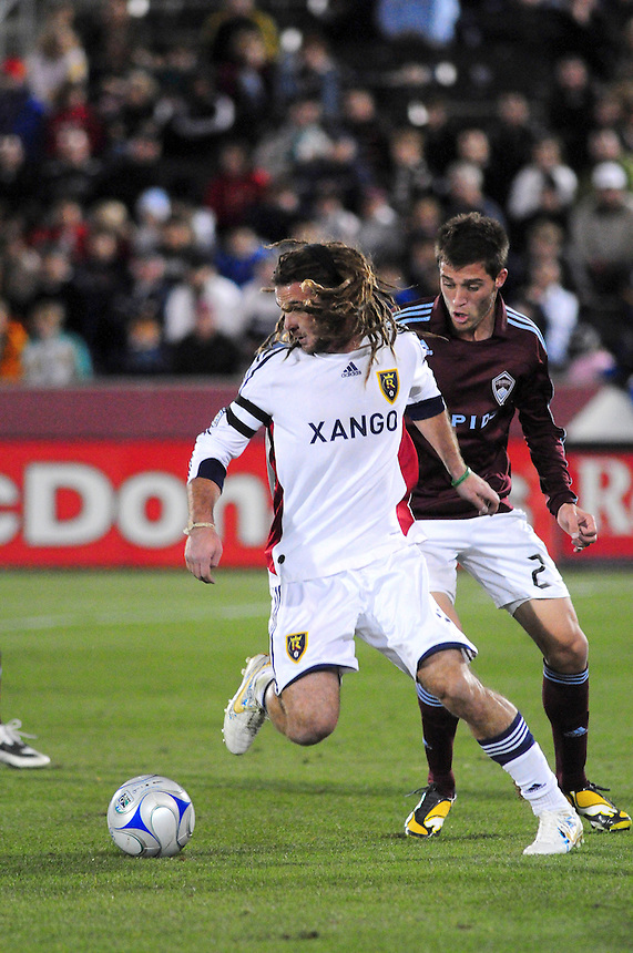 25 October 08: Real Salt Lake midfielder Kyle Beckerman (in white) dribbles the ball against Rapids defender Kosuke Kimura. Real Salt Lake tied the Colorado Rapids 1-1 at Dick's Sporting Goods Park in Commerce City, Colorado. The tie advanced Real Salt Lake to the playoffs.