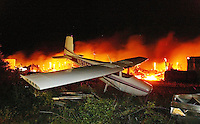 A small single-engine sits alone as what remains of the Bob Lee Airport hangers burns in the background late Monday night May 13, 2002. The fire which started just before 9 pm completely destroyed the area and most of the aircraft. This plane, along with a few others were rescued just before flames engulfed the rest of the building.(Kelly Jordan)..**FOR LYNN STORY**