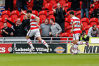 John Marquis of Doncaster Rovers (left) celebrates after he scores his team's second goal of the game to make it 2-1 during the Sky Bet League 2 match between Doncaster Rovers and Wycombe Wanderers at the Keepmoat Stadium, Doncaster, England on 29 October 2016. Photo by David Horn.