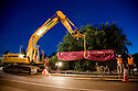 "Night construction crew works on installing 24"" diameter pipes made of recycled steel in a trench as part of a reclaimed water pipeline. The pipes are first covered with purple plastic sleeves to prevent corrosion and to identify them as carrying reclaimed water. The cities of Palo Alto and Mountain View are jointly constructing a reclaimed water pipeline to carry recycled water from the Palo Alto Regional Water Quality Control Plant to customers along East Bayshore Parkway and Mountain View's North Bayshore area."