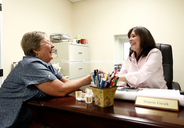 Southbury, CT- 09 July 2014-070914CM01-  Sharon Gesek, right, director of elderly services in Southbury, chats with Sandy Saren, Director of Social Services inside Gesek's office on Wednesday. Gesek will be leaving the Senior Center and will become the program director at the Area Agency on Aging in Bridgeport. .    Christopher Massa Republican-American