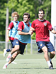 Carlos Bocanegra (r) defends against Ben Olsen (center) on Saturday, May 20th, 2006 at SAS Soccer Park in Cary, North Carolina. The United States Men's National Soccer Team held a training session as part of their preparations for the upcoming 2006 FIFA World Cup Finals being held in Germany.
