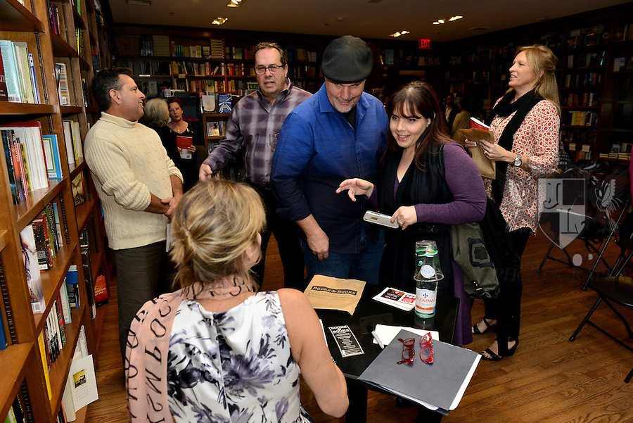 "CORAL GABLES, FLORIDA - JANUARY 29: Liane Sangollo greets fans and signs copies of her book ""SOS Love: 5 Realities of Online Dating Dependence"" at Books and Books on January 29, 2016 in Coral Gables, Florida.  ( Photo by Johnny Louis / jlnphotography.com )"