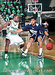 Jackson State Tigers guard Phillip Williams (21)  drives in for a basket around North Texas Mean Green guard Josh White (10) in the game between the Jackson State Tigers and the University of North Texas Mean Green at the North Texas Coliseum,the Super Pit, in Denton, Texas. UNT defeated Jackson 68 to 49
