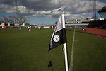 A corner flag with club logo at the Commonwealth Stadium at Meadowbank during the Scottish Lowland League match between Edinburgh City (white shirts) and city rivals Spartans, which was won by the hosts by 2-0. Edinburgh City were the 2014-15 league champions and progressed to a play-off to decide whether there would be a club promoted to the Scottish League for the first time in its history. The Commonwealth Stadium hosted Scottish League matches between 1974-95 when Meadowbank Thistle played there.
