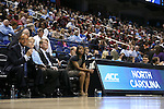 27 March 2015: UNC head coach Sylvia Hatchell (2nd from left) with assistant coaches Bill Lee (left), Andrew Calder (2nd from right), and Ivory Latta (right). The University of North Carolina Tar Heels played the University of South Carolina Gamecocks at the Greensboro Coliseum in Greensboro, North Carolina in a 2014-15 NCAA Division I Women's Basketball Tournament regional semifinal game. South Carolina won the game 67-65.