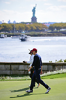 Jordan Spieth (USA) walks down 14 with the Statue of Liberty on the horizon during round 3 Foursomes of the 2017 President's Cup, Liberty National Golf Club, Jersey City, New Jersey, USA. 9/30/2017.<br /> Picture: Golffile | Ken Murray<br /> <br /> All photo usage must carry mandatory copyright credit (&copy; Golffile | Ken Murray)