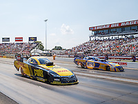 Sep 5, 2016; Clermont, IN, USA; NHRA funny car driver Del Worsham (near) races alongside Ron Capps during the US Nationals at Lucas Oil Raceway. Mandatory Credit: Mark J. Rebilas-USA TODAY Sports