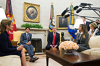 United States President Donald Trump (2nd-R) and first lady Melania Trump (R) meet with Canadian Prime Minister Justin Trudeau (2nd-L) and his wife Sophie Gr&Egrave;goire in the Oval Office at the White House in Washington, D.C. on October 11, 2017. <br /> Credit: Kevin Dietsch / Pool via CNP /MediaPunch<br /> CAP/MPI/RS<br /> &copy;RS/MPI/Capital Pictures