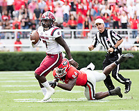 ATHENS, GA - OCTOBER 12: Dakereon Joyner #7 of the South Carolina Gamecocks eludes the tackle of Walter Grant #84 of the Georgia Bulldogs during a game between University of South Carolina Gamecocks and University of Georgia Bulldogs at Sanford Stadium on October 12, 2019 in Athens, Georgia.