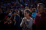 Mary, center, and Jerry Bruce, left, at  a vigil for the Granite Mountain Hotshots, 19 of who perished in the Yarnell Fire Sunday at Prescott High School in Prescott, Arizona, July 2, 2013.