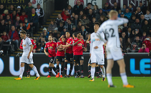 24th October 2017, Liberty Stadium, Swansea, Wales; Carabao Cup, round of 16, Swansea City versus Manchester United; Jesse Lingard of Manchester United celebrates with Chris Smalling  after scoring the first goal in the 21st minute to make the score 1-0