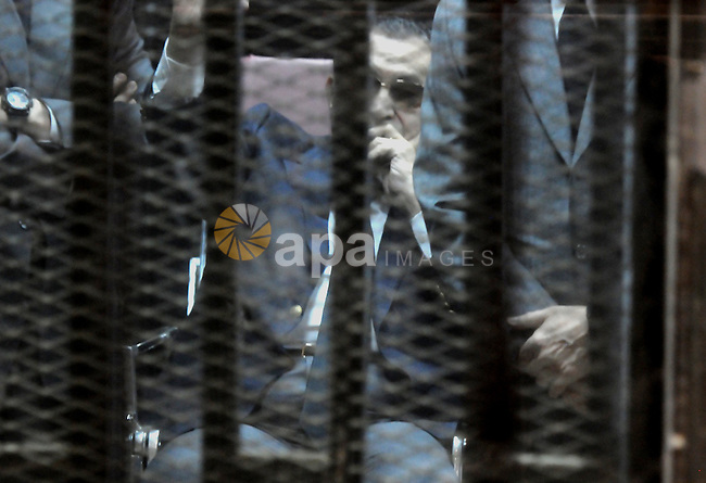 Ousted Egyptian president Hosni Mubarak sits in the defendant s cage during his verdict hearing in a retrial for embezzlement on May 9, 2015 in the capital Cairo. The Egyptian court sentenced Mubarak and his two sons to three years in prison. Photo by Stranger
