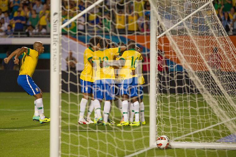 Miami, FL - Saturday, Nov 16, 2013: Brazil vs Honduras during an international friendly at Miami's Sun Life Stadium. Brazilian team celebrates Maicon's goal.