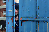 A Macclesfield Town fans watches from outside the gates during Macclesfield Town vs Kingstonian, Emirates FA Cup Football at the Moss Rose Stadium on 10th November 2019