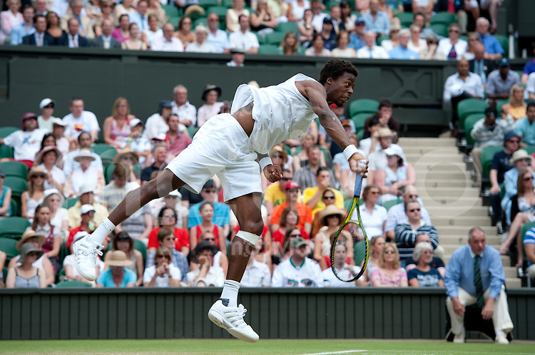Gael Monfils (FRA) plays against Lleyton Hewitt (AUS) on Centre Court. The Wimbledon Championships 2010 The All England Lawn Tennis & Croquet Club  Day 5 Friday 25/06/2010