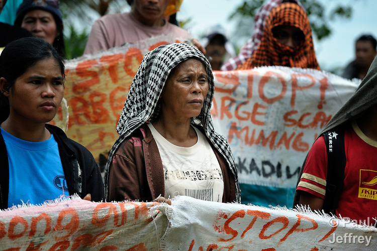 Lita Egot participates in a June 4, 2012, rally of small-scale miners in a protest outside the Mt. Diwata offices of the Philippine Mining Development Corporation, a front company for foreign mining companies that seeks to install a large-scale open pit gold mine in the Diwalwal area on the Philippines' southern island of Mindanao. Egot, 50, operates with her family a small gold mine in the area, also known as Mt. Diwata. She and the other small miners were given a notice to evacuate the area by June 5 or risk being forcibly removed by the military. They have defiantly refused to leave. .