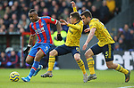 Crystal Palace's Jordan Ayew is challenged by Arsenal's Lucas Torreira (C) and Sokratis Papastathopoulos during the Premier League match at Selhurst Park, London. Picture date: 11th January 2020. Picture credit should read: Paul Terry/Sportimage