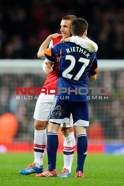 Arsenal Forward Lukas Podolski (GER) hugs Fulham Defender Sascha Riether (GER) after Arsenal win the match 2-0 -  - 18/01/14 - SPORT - FOOTBALL - Emirates Stadium - Arsenal v Fulham - Barclays Premier League.<br /> Foto nph / Meredith<br /> <br /> ***** OUT OF UK *****