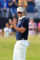 Adam Scott (AUS) sinks his putt on the 14th green during Thursday's Round 1 of the 145th Open Championship held at Royal Troon Golf Club, Troon, Ayreshire, Scotland. 14th July 2016.<br /> Picture: Eoin Clarke | Golffile<br /> <br /> <br /> All photos usage must carry mandatory copyright credit (&copy; Golffile | Eoin Clarke)