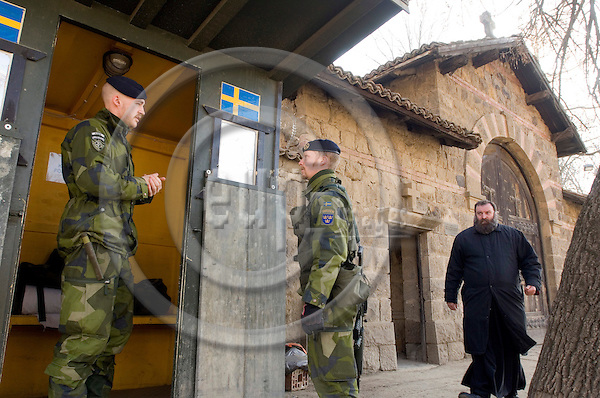 GRACANICA - KOSOVO 15 FEB 2008 -- Kosovo awaiting declaration of independence: Swedish soldiers Stefan Grotting (R) and Peter Tengqvist (L) are guarding the serb monastery in Gracanica.  -- PHOTO: © GORM K. GAARE/ EUP-BERLIN..