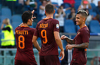 Calcio, Serie A: Roma vs Udinese. Roma, stadio Olimpico, 20 agosto 2016.<br /> Roma&rsquo;s Diego Perotti, left, celebrates with teammates Edin Dzeko, center, and Leandro Paredes, after scoring his second goal on a penalty kick during the Italian Serie A football match between Roma and Udinese at Rome's Olympic Stadium, 20 August 2016. Roma won 4-0.<br /> UPDATE IMAGES PRESS/Riccardo De Luca