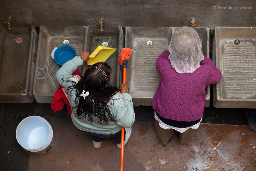 Two residents of Casa Xochiquetzal wash their clothes at the shelter in Mexico City, Mexico on September 3, 2013. Casa Xochiquetzal is a shelter for elderly sex workers in Mexico City. It gives the women refuge, food, health services, a space to learn about their human rights and courses to help them rediscover their self-confidence and deal with traumatic aspects of their lives. Casa Xochiquetzal provides a space to age with dignity for a group of vulnerable women who are often invisible to society at large. It is the only such shelter existing in Latin America. Photo by Bénédicte Desrus