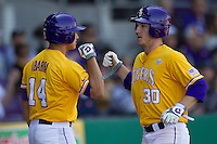 LSU Tigers shortstop Alex Bregman #30 is greeted by teammate Christian Ibarra #14 after scoring against the Auburn Tigers in the NCAA baseball game on March 24, 2013 at Alex Box Stadium in Baton Rouge, Louisiana. LSU defeated Auburn 5-1. (Andrew Woolley/Four Seam Images).