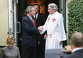 "Washington, D.C. - April 3, 2005 -- United States President George W. Bush shakes hands with Doctor Luis Leon after attending the eight AM Sunday service at Saint John's Episcopal Church in Washington, DC on April 3, 2005.  <br /> Credit: Dennis Brack - Pool via CNP<br /> <br /> Pool Report: President of the United States (POTUS), wearing a dark blue suit, light blue shirt and red tie, and Laura Bush, in charcoal grey pants suit with white piping, emerged from the White House onto the south driveway at 7:55 a.m. POTUS gave a quick wave and they ducked into the limousine for the two-minute motorcade to St. John's Church at 1525 H St. NW. One more wave to the pool as POTUS entered through the side door.<br /> Inside the church, POTUS and the First Lady were seated near the front, on the left side of the center section. Readings were on the resurrection of Christ and the 13-minute sermon , by the Rev. Spencer M. Rice, was about letting go of your expectations so that G-d can reveal himself to you. There was just one mention of the pontiff during the service, in a prayer before communion, in which an unidentified priest offered a prayer ""for his holiness Pope John Paul II"" along with the president, members of Congress, those celebrating birthdays and anniversaries, victims of the tsunami and others. When the Rev. Luis Leon asked parishoners to greet each other, POTUS kissed Laura on the cheek and reached across the aisle to his left to shake hands with others, including FBI Director Robert S. Mueller. POTUS and Laura both went up to take communion. POTUS emerged from the church at 8:42, accompanied by Laura and Rev. Leon, whose hand he shook. Motorcade rolled at 8:43 and parked in south driveway at 8:45, when POTUS re-entered the White House to get ready for a mountain biking expedition."