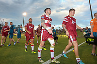 Picture by David Neilson/SWpix.com/PhotosportNZ - 10/02/2018 - Rugby League - Betfred Super League - Wigan Warriors v Hull FC  - WIN Stadium, Wollongong, Australia - Wigan leave the field after victory over Hull FC.