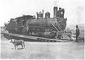 3/4 view of K-27 #450 on turntable in Gunnison with several men around train.  The same dog as found in RD107-024.<br /> D&amp;RG  Gunnison, CO  1910