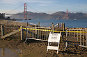 A sign marks the beach closure at Crissy Field due to the Cosco Busan oil spill while the Golden Gate Bridge spans the background (11/12/07). On November 7, 2007 the Cosco Busan container ship spilled an estimated 58,000 gallons of bunker fuel into San Francisco Bay after striking a tower of the San Francisco-Oakland Bay Bridge.