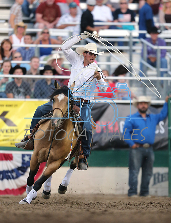 Asher Freeman competes in the team roping event at the Reno Rodeo in Reno, Nev. on Friday, June 19, 2015.<br /> Photo by Cathleen Allison/Nevada Photo Source