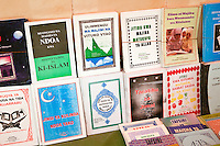 Zanzibar, Tanzania.  Bookstand selling books about Islam in Swahili or Arabic,  opposite the Jibril mosque in Stone Town.