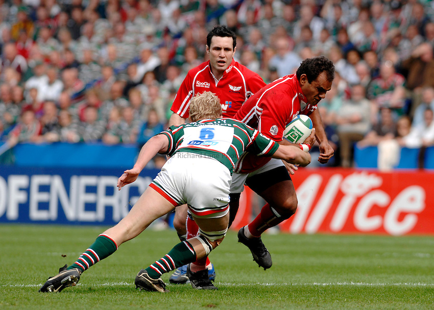 Photo: Richard Lane..Leicester Tigers v Llanelli Scarlets. Heineken Cup, Semi Final. 21/04/2007. .Scarlets' Deacon Manu is tackled by Tigers' Lewis Moody.