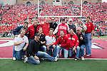 The 1990 NCAA Championship Hockey Team of the Wisconsin Badgers poses for a photo after being introduced during the Wisconsin Badgers NCAA college football game against the San Jose State Spartans on September 11, 2010 at Camp Randall Stadium in Madison, Wisconsin. The Badgers beat San Jose State 27-14. (Photo by David Stluka)