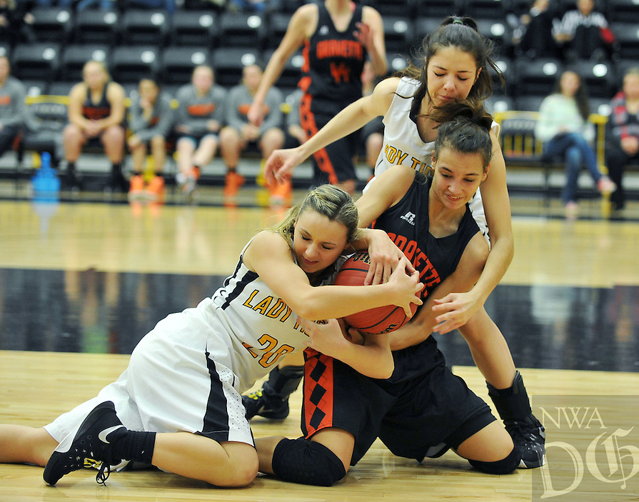 NWA Democrat-Gazette/MICHAEL WOODS &bull; @NWAMICHAELW<br /> Gravette's Tori Foster (22), Prairie Grove's Camree Bartholomew (20) and Prairie Groves Taylor Doss (10) fight for a loose ball Tuesday January 26, 2016 during their game at Prairie Grove High School.