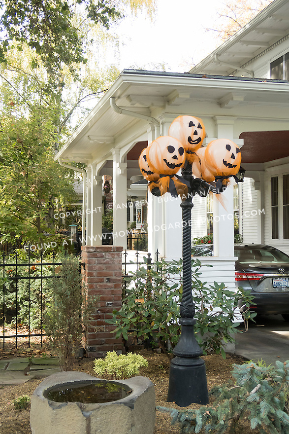 Whimsical Halloween decorations on a light post outside a home in Walla Wall, WA