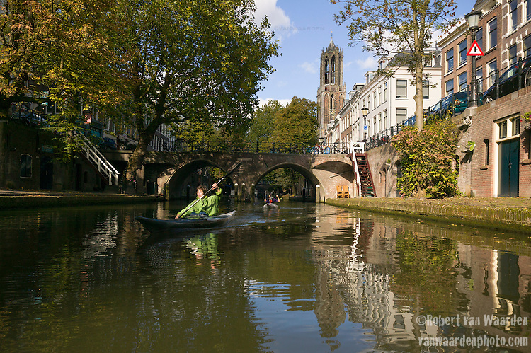 Two woman kayaking  on the canals of Utrecht, the Netherlands.